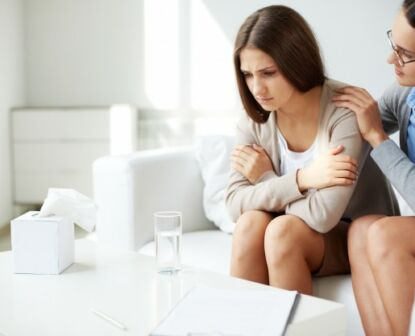 Image a health professional assisting a lady with addiction problem