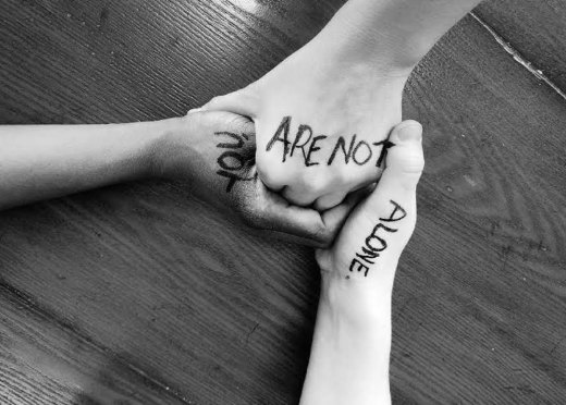 A picture showing hands held together for suicide prevention