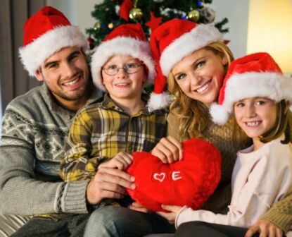Family smiling and celebrating christmas holiday season