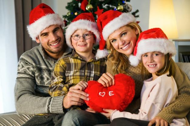Family smiling and celebrating christmas holiday season